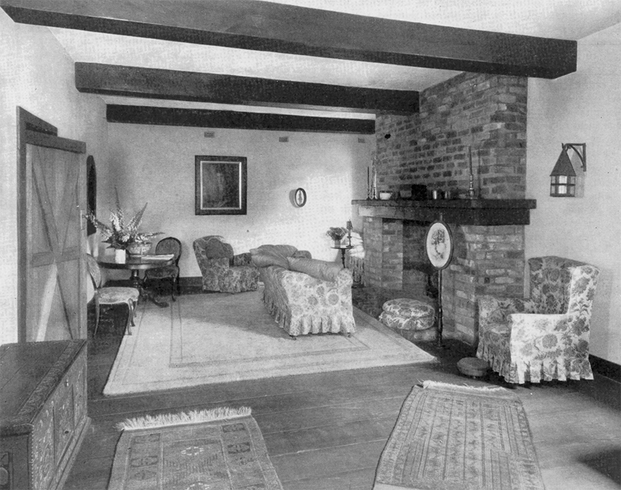 "Original caption: ""In the living room, with its big ceiling beams and wide floorboards, friends seem to think the experiment has quite justified itself."""