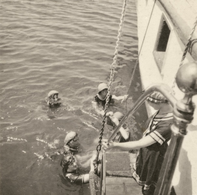 A photo from Marjorie's collection, showing nurses swimming off the side of a boat.